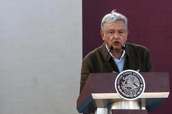 Mexican President Andres Manuel Lopez Obrador is seen speaking at a June 8, 2019 rally in the Mexican border city of Tijuana, where he said that the pact with the US meant 'there will not be an economic or financial crisis in Mexico' (AFP Photo/Guillermo Arias)