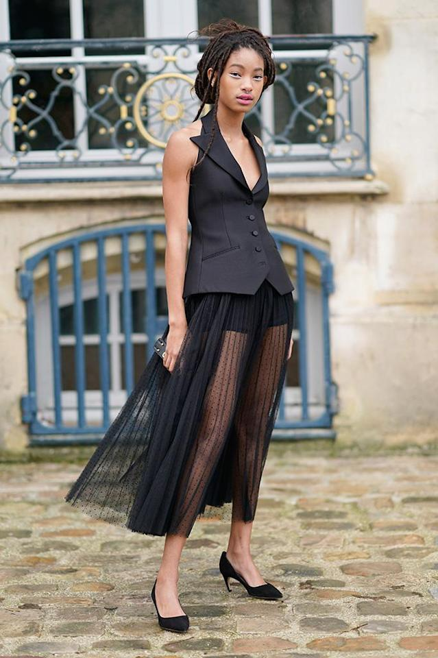 <p>The 17-year-old actress looked very grown up in sheer black at the Christian Dior Haute Couture spring-summer 2018 show in Paris on Monday. (Photo: Edward Berthelot/Getty Images for Christian Dior) </p>