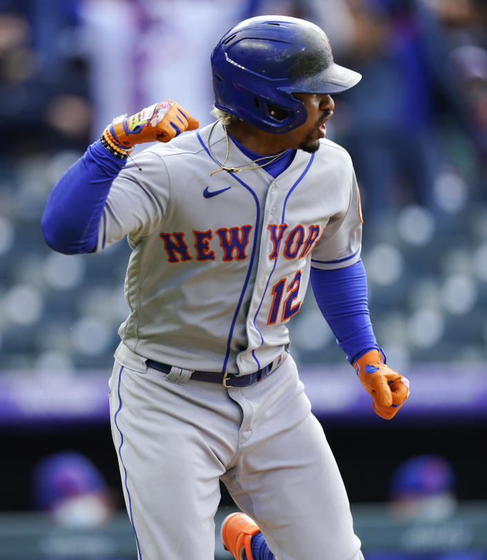 New York Mets' Francisco Lindor reacts as he heads up the first-base line after hitting an RBI single off Colorado Rockies relief pitcher Daniel Bard during the seventh inning of a baseball game Saturday, April 17, 2021, in Denver. The Mets won 4-3 in the first game of a doubleheader. (AP Photo/David Zalubowski)