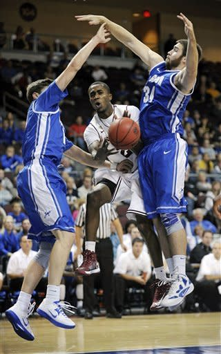 Arizona State's Chris Colvin (2) passes the ball between Creighton's Grant Gibbs and Ethan Wragge (34) during the first half of an NCAA college basketball game at the Continental Tire Las Vegas Invitational tournament on Saturday, Nov. 24, 2012, in Las Vegas. (AP Photo/David Becker)