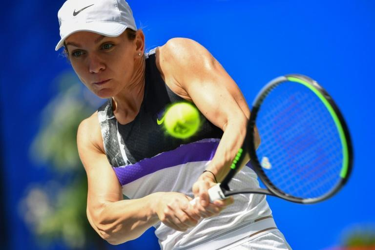 The 28-year-old Halep was forced out of last week's Wuhan Open because of her troublesome back, which she says has plagued her for more than a decade (AFP Photo/HECTOR RETAMAL)