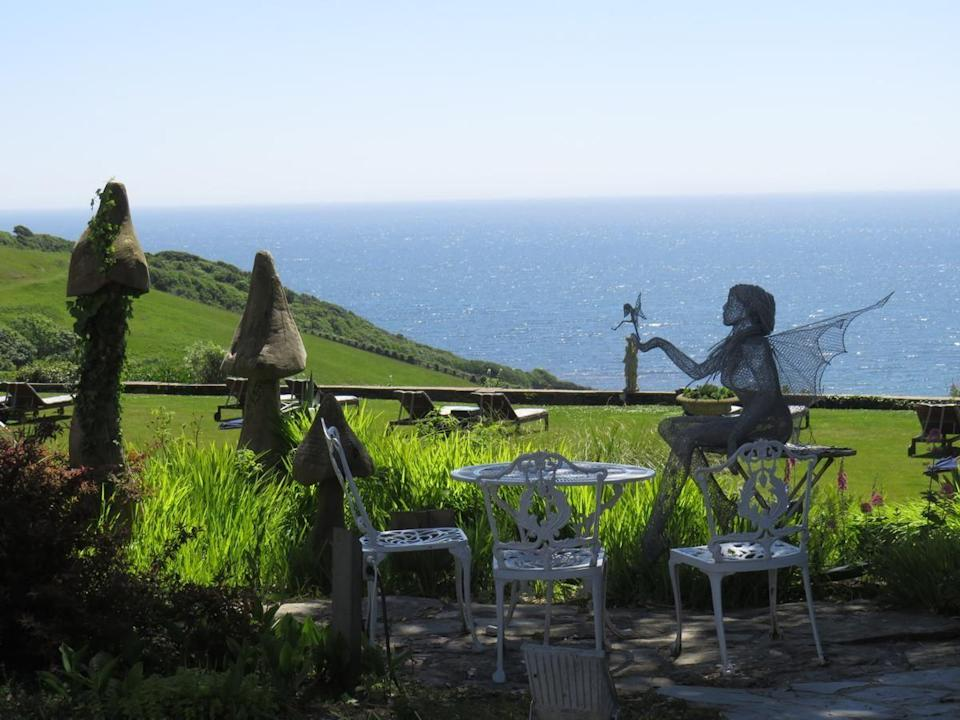 """<p>Boasting a captivating clifftop setting at Porthallow between Looe and Polperro, the luxury <a href=""""https://go.redirectingat.com?id=127X1599956&url=https%3A%2F%2Fwww.booking.com%2Fhotel%2Fgb%2Ftalland-bay.en-gb.html%3Faid%3D1922306%26label%3Dunusual-hotels-uk&sref=https%3A%2F%2Fwww.goodhousekeeping.com%2Fuk%2Flifestyle%2Ftravel%2Fg34667984%2Fquirky-unusual-hotels-uk%2F"""" rel=""""nofollow noopener"""" target=""""_blank"""" data-ylk=""""slk:Talland Bay Hotel"""" class=""""link rapid-noclick-resp"""">Talland Bay Hotel</a> is just yards from the South West Coast Path and Talland Bay's beach.</p><p>The eye-catching and original art and design features are as much a part of the experience as the service, setting and food. There is an air of magic in the cornucopia of sculptures decorating the sub-tropical seaside gardens, from wire fairies to toad stalls and giant teacups. </p><p>Step inside to encounter further eclectic touches – some the legacy of the previous owners, some acquired or created since – including flamingos and zebra print sofas, a lion's head emerging from a coffee table, a Mad Hatter's top hat here, a disembodied mannequin there. This is a boutique beachside retreat with a difference.</p><p><a href=""""https://www.goodhousekeepingholidays.com/offers/talland-bay-hotel-cornwall"""" rel=""""nofollow noopener"""" target=""""_blank"""" data-ylk=""""slk:Read our review of Talland Bay Hotel."""" class=""""link rapid-noclick-resp"""">Read our review of Talland Bay Hotel.</a></p><p><a class=""""link rapid-noclick-resp"""" href=""""https://go.redirectingat.com?id=127X1599956&url=https%3A%2F%2Fwww.booking.com%2Fhotel%2Fgb%2Ftalland-bay.en-gb.html%3Faid%3D1922306%26label%3Dunusual-hotels-uk&sref=https%3A%2F%2Fwww.goodhousekeeping.com%2Fuk%2Flifestyle%2Ftravel%2Fg34667984%2Fquirky-unusual-hotels-uk%2F"""" rel=""""nofollow noopener"""" target=""""_blank"""" data-ylk=""""slk:CHECK AVAILABILITY"""">CHECK AVAILABILITY</a></p>"""
