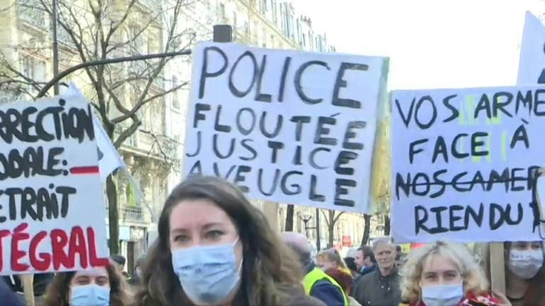 People protest against a proposed French security law that would curb filming of police actions