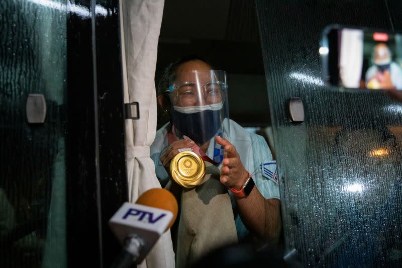 The Philippines' first Olympic gold medalist Hidilyn Diaz arrives home from Tokyo 2020