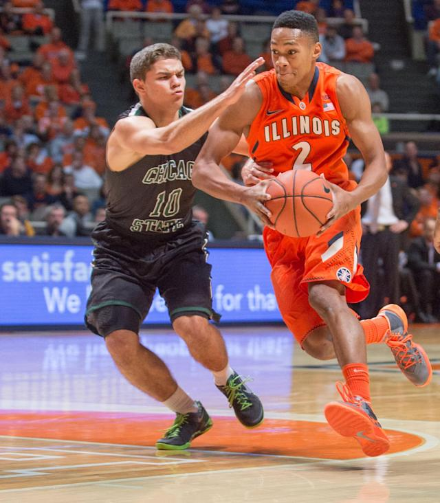 Illinois' Joseph Bertrand (2) drives past Chicago State's Kurt Karis (10) during the first half of an NCAA college basketball game on Friday, Nov. 22, 2013, in Champaign, Ill. (AP Photo/Darrell Hoemann)