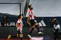 Athletic Bilbao's Raul Garcia, right, celebrates with teammates after scoring the opening goal during Spanish Super Cup semi final soccer match between Real Madrid and Athletic Bilbao at La Rosaleda stadium in Malaga, Spain, Thursday, Jan. 14, 2021. (AP Photo/Jose Breton)
