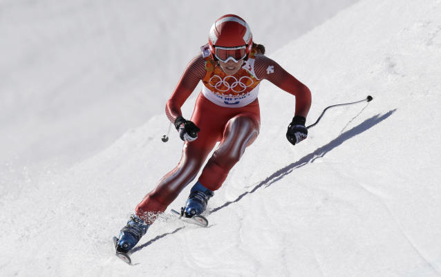Switzerland's Dominique Gisin makes a turn in the women's downhill at the Sochi 2014 Winter Olympics, Wednesday, Feb. 12, 2014, in Krasnaya Polyana, Russia. (AP Photo/Luca Bruno)