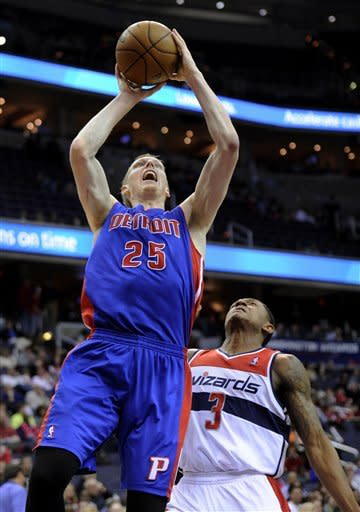 Detroit Pistons forward Kyle Singler (25) goes to the basket against Washington Wizards guard Bradley Beal (3) during the first half of an NBA basketball game, Saturday, Dec. 22, 2012, in Washington. (AP Photo/Nick Wass)