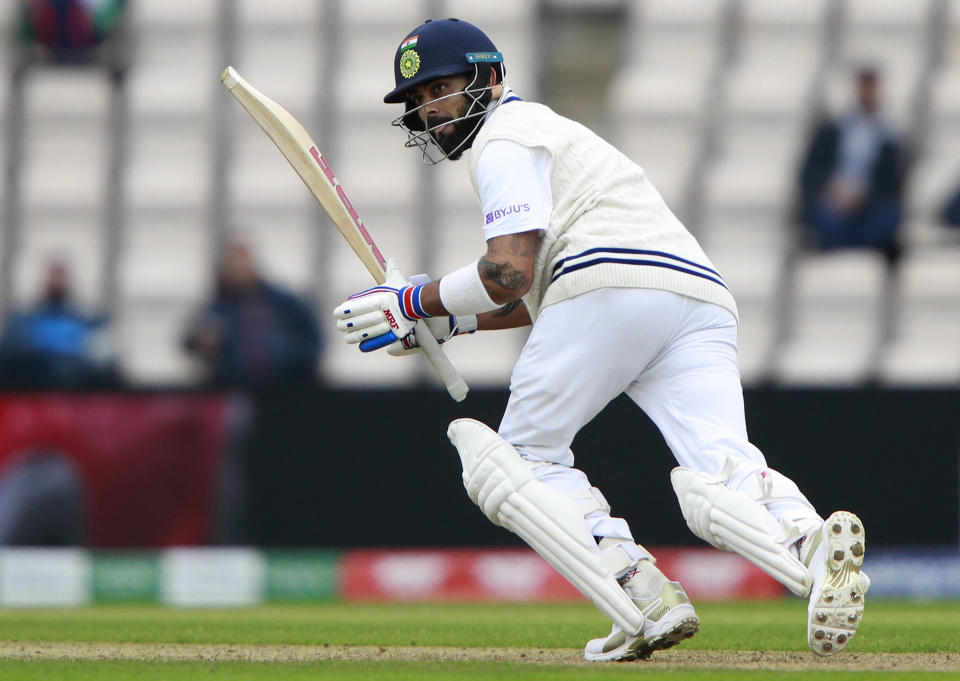 India's captain Virat Kohli watches the ball after playing a shot during the second day of the World Test Championship final cricket match between New Zealand and India, at the Rose Bowl in Southampton, England, Saturday, June 19, 2021. (AP Photo/Ian Walton)