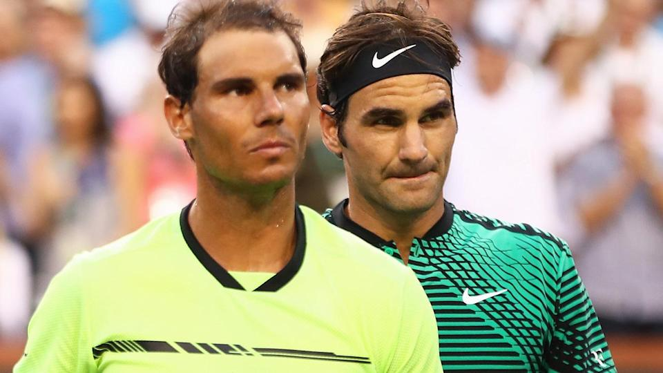 Rafael Nadal and Roger Federer. (Photo by Clive Brunskill/Getty Images)