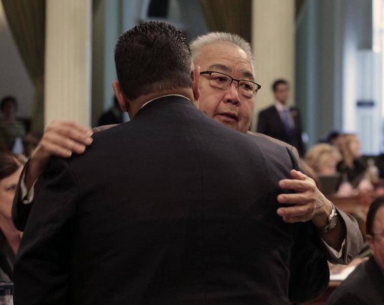Assemblyman Warren Furutani, D-Lakewood, right, receives a congratulatory hug from Assembly Speaker John Perez, D-Los Angeles, after his pension reform bill was approved by the Assembly at the Capitol in Sacramento, Calif., Friday, Aug. 31, 2012. The measure, AB340, a sweeping pension compromise plan negotiated by Gov. Jerry Brown and Democratic legislative leaders, was approved by a 49-8 vote. (AP Photo/Rich Pedroncelli)