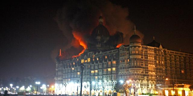 Fire breaks out at the Taj hotel in Mumbai on November 26, 2008. Nearly 80 people were killed in a series of shootings and blasts across Mumbai, when 10 Pakistani terrorists, armed men with automatic weapons and grenades, targeted two of Mumbai's top luxury hotels and the main Chhatrapati Shivaji railway station. Photo: PAL PILLAI/AFP via Getty Images