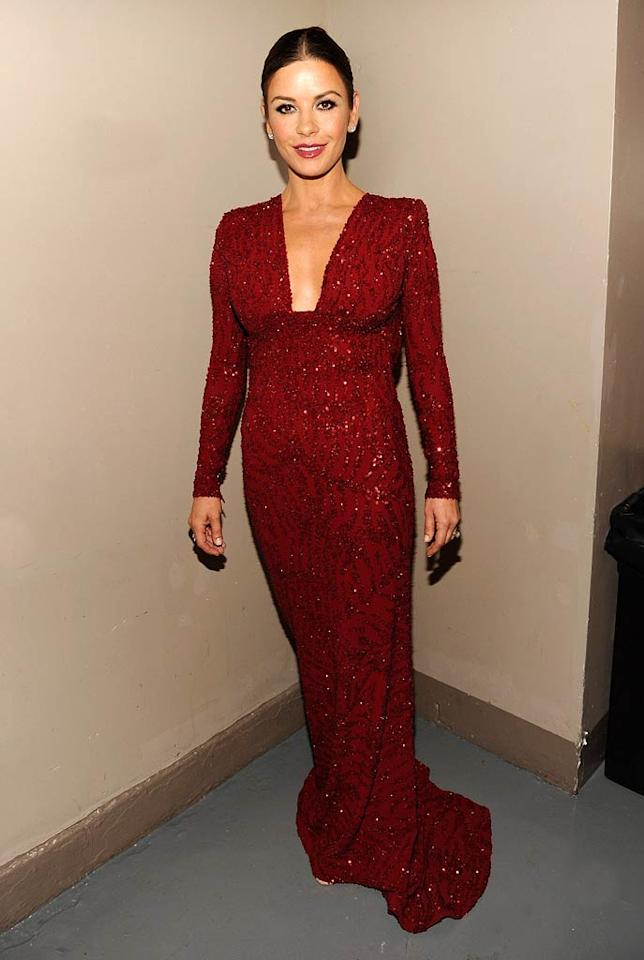 """Catherine Zeta-Jones has been missing in action for quite some time, but the Oscar winner made a triumphant return to the spotlight at the 65th annual Tony Awards in a blood-red, embellished Elie Saab stunner. Van Cleef & Arpels jewelry, the perfect amount of makeup, and a tight bun completed her flawless look. Kevin Mazur/<a href=""""http://www.wireimage.com"""" target=""""new"""">WireImage.com</a> - June 12, 2011"""