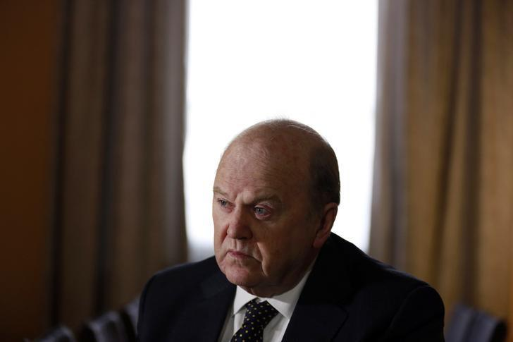 Ireland's Finance Minister Noonan attends an interview with Reuters at his office in central Dublin