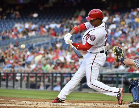May 21, 2018; Washington, DC, USA; Washington Nationals left fielder Juan Soto (22) hits a three run home run during the second inning against the San Diego Padres at Nationals Park. Mandatory Credit: Brad Mills-USA TODAY Sports