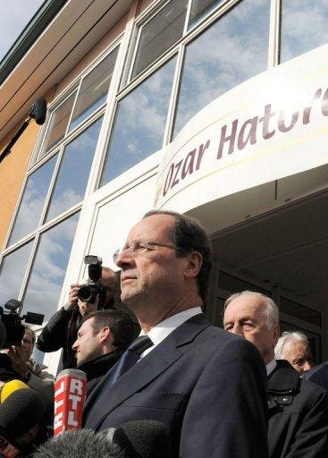"France's opposition Socialist Party presidential candidate Francois Hollande (C) speaks to journalists, in front of the ""Ozar Hatorah"" Jewish school where four people were killed"
