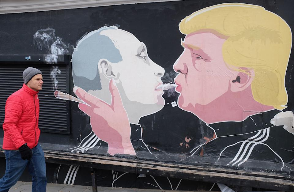 A mural of U.S. President Donald Trump (R) and Russian President Vladimir Putin 'shotgunning' a marijuana joint is seen on March 17, 2017 in Vilnius, Lithuania.