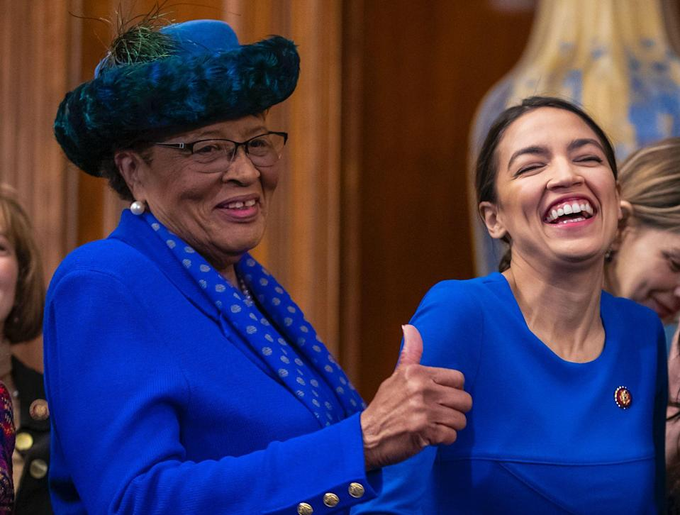 Rep. Alma Adams D-N.C., left, with Rep. Alexandria Ocasio-Cortez, D-N.Y., smiles during an event to advocate for the Paycheck Fairness Act on the 10th anniversary of President Barack Obama signing the Lilly Ledbetter Fair Pay Act, at the Capitol in Washington, Wednesday, Jan. 30, 2019.(AP Photo/J. Scott Applewhite)