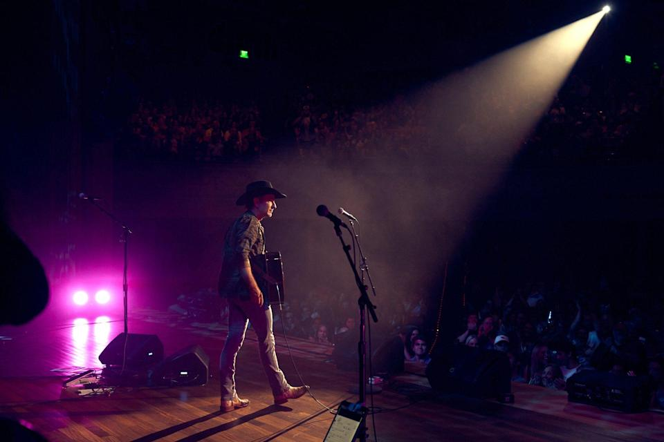 """<p>In one of the most poignant performances of the night, Craig Campbell silenced the crowd with just his guitar and a soul-baring performance of his hit song """"Outskirts of Heaven.""""</p>"""