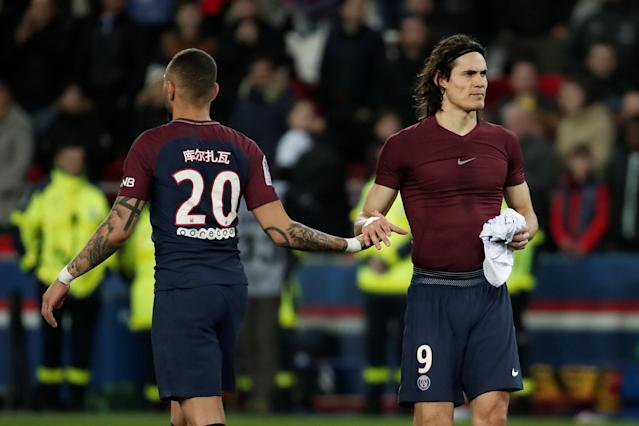 Soccer Football - Ligue 1 - Paris St Germain vs RC Strasbourg - Parc des Princes, Paris, France - February 17, 2018 Paris Saint-Germain's Edinson Cavani shakes hands with Layvin Kurzawa at the end of the match REUTERS/Benoit Tessier