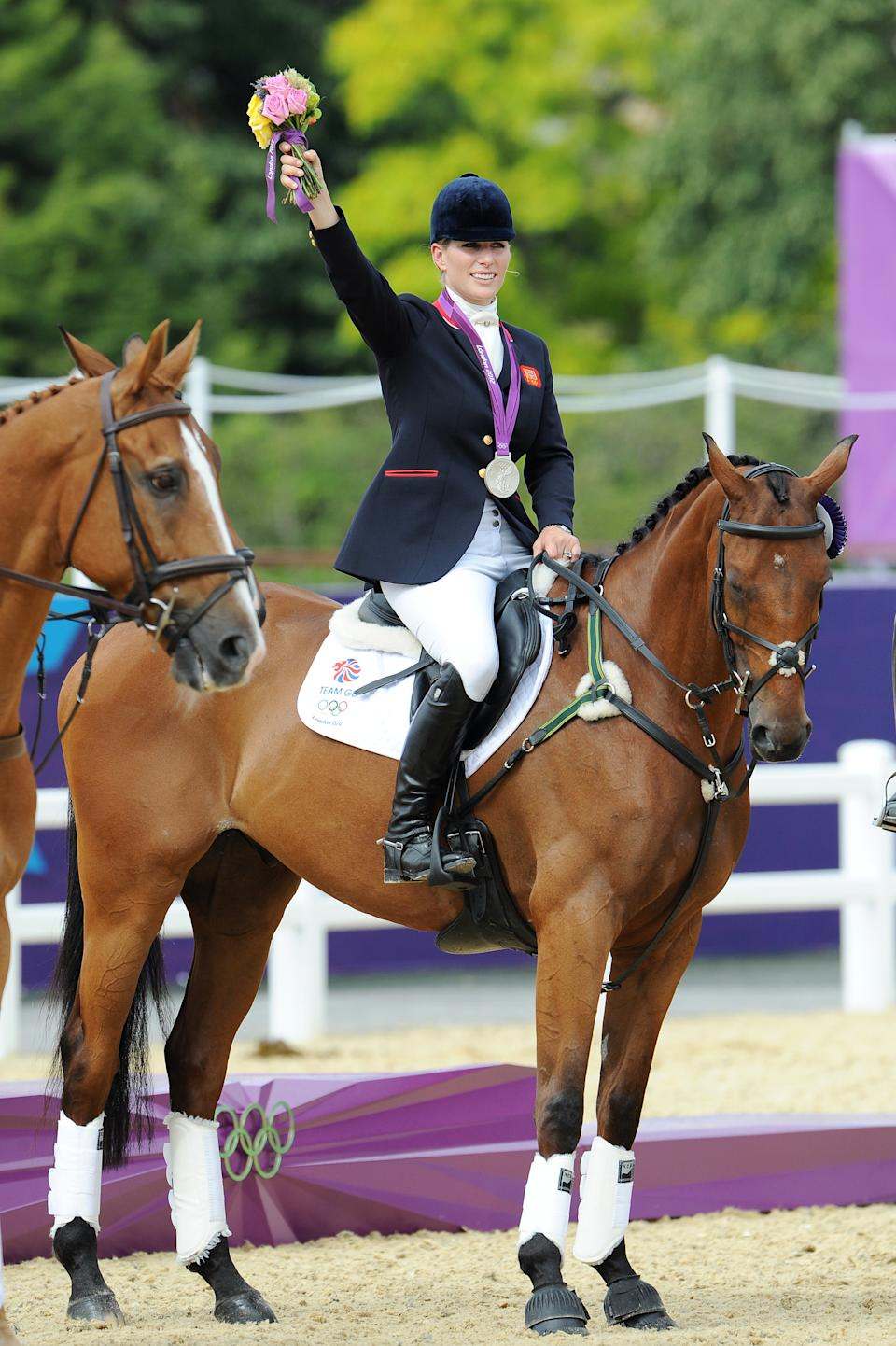 Zara Phillips holds up flowers at the Show Jumping Eventing Equestrian on Day 4 of the London 2012 Olympic Games at Greenwich Park on July 31, 2012 in London, England.