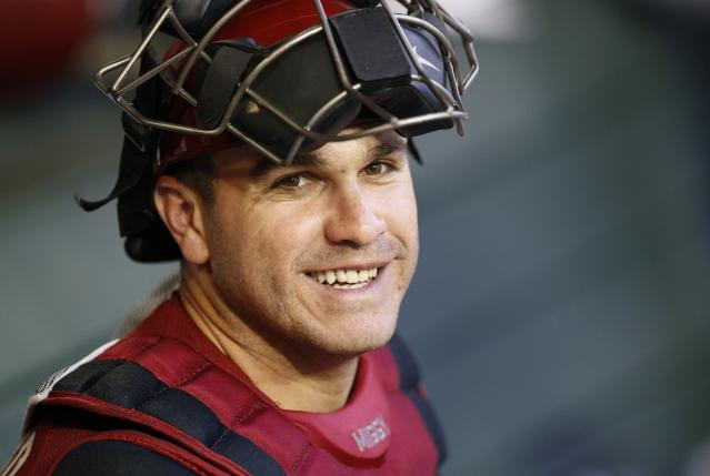 Arizona Diamondbacks' Miguel Montero smiles in the dugout prior to the Diamondbacks' spring training baseball game against the Chicago Cubs, Friday, March 28, 2014, in Phoenix. (AP Photo/Ross D. Franklin)