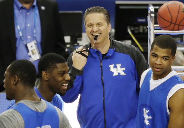Kentucky head coach John Calipari shares a light moment with the team during practice for their NCAA Final Four tournament college basketball semifinal game Friday, April 4, 2014, in Dallas. Kentucky plays Wisconsin on Saturday, April 5, 2014. (AP Photo/Tony Gutierrez)