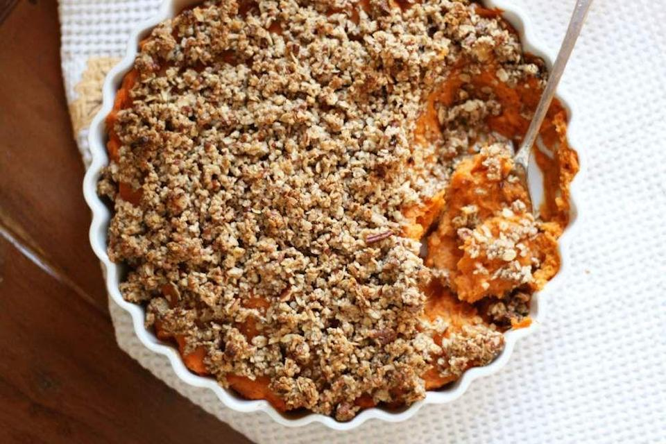 "<p>The creamy sweetness of mashed sweet potatoes topped with the crumbly goodness of pecans, oats, and maple syrup? we'll have seconds, please.</p><p><em><a href=""http://www.vegukate.com/post.php?s=2014-11-24-sweet-potato-casserole-with-crunchy-pecan-crumble"" rel=""nofollow noopener"" target=""_blank"" data-ylk=""slk:Get the recipe from Vegukate »"" class=""link rapid-noclick-resp"">Get the recipe from Vegukate »</a></em></p>"