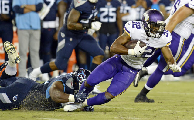 Minnesota Vikings running back Roc Thomas (32) is brought down by Tennessee Titans defensive end Julius Warmsley in the first half of a preseason NFL football game Thursday, Aug. 30, 2018, in Nashville, Tenn. (AP Photo/Mark Zaleski)