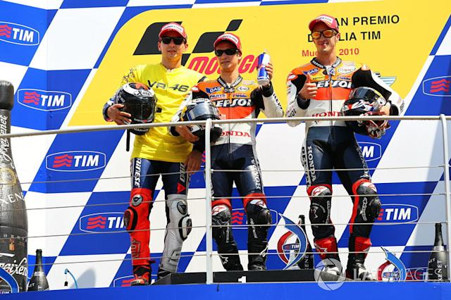 "Podio: 1º Dani Pedrosa, 2º Jorge Lorenzo, 3º Andrea Dovizioso <span class=""copyright"">Gold and Goose / Motorsport Images</span>"