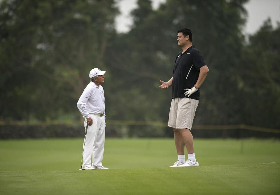 <p>Gary Player and Yao Ming during the World Celebrity Pro-Am 2016 Mission Hills China Golf Tournament.</p>