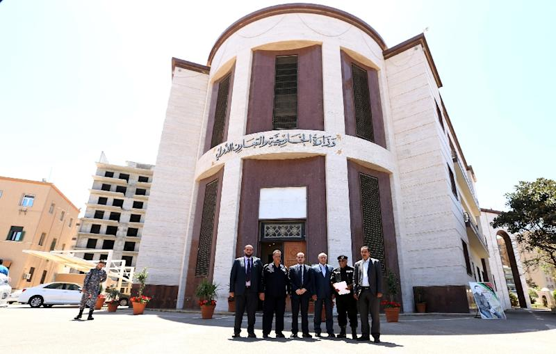 Libyan officials gather outside the Foreign Ministry in Tripoli, on April 25, 2016