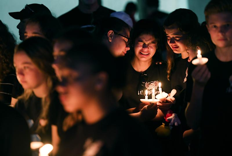 Students gather to honor of the victims of the school shooting in Parkland, Fla.