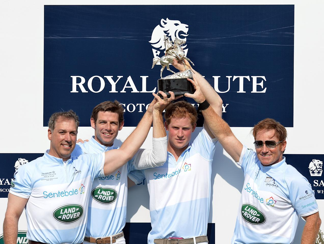 (left to right) Michael Carrazza, Malcolm Borwick, Prince Harry and Marc Ganzi, lift the winners trophy following the Sentebale Royal Salute Polo Cup, at the Greenwich Polo Club, Connecticut, USA, in which Prince Harry played in as part of his tour of the USA.