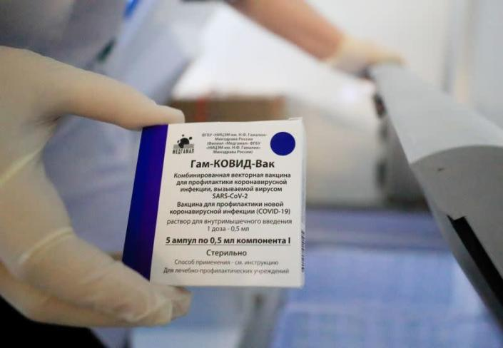 FILE PHOTO: A medical worker holds a box of Sputnik V (Gam-COVID-Vac) vaccine against the coronavirus disease (COVID-19) at a mobile vaccination centre in a dacha community in Moscow Region