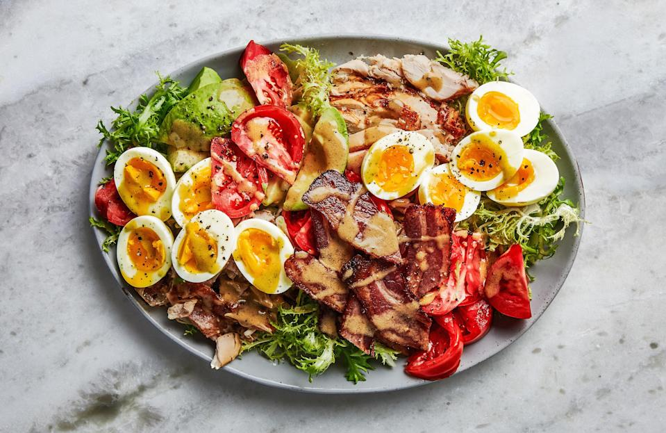 """Add turkey instead of chicken here. The real flavor boost, though, comes from the bacon, which appears as crispy slices and the rich base of a warm vinaigrette. <a href=""""https://www.epicurious.com/recipes/food/views/chicken-cobb-salad?mbid=synd_yahoo_rss"""" rel=""""nofollow noopener"""" target=""""_blank"""" data-ylk=""""slk:See recipe."""" class=""""link rapid-noclick-resp"""">See recipe.</a>"""