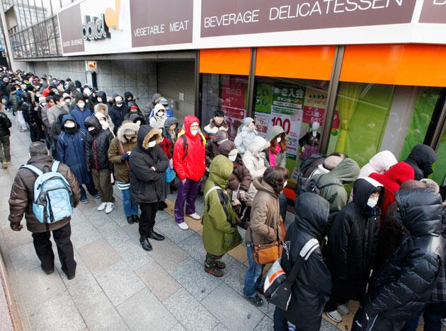 People queue outside a supermarket in downtown Sendai, Japan, Thursday, March 17, 2011. (AP Photo/Mark Baker)