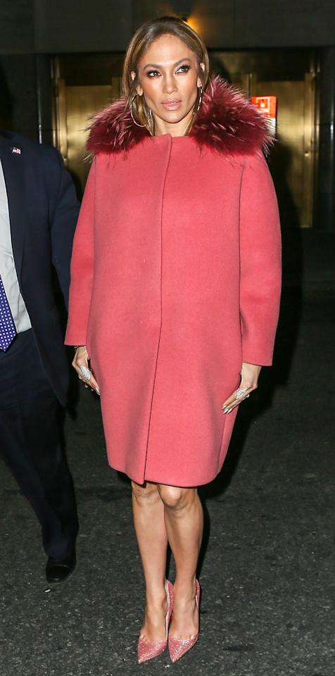 """<p>J.Lo arrived at NBC studios for <a rel=""""nofollow"""" href=""""http://www.instyle.com/news/jennifer-lopez-daughter-sewed-custom-dress-mom"""">her appearance on </a><em><a rel=""""nofollow"""" href=""""http://www.instyle.com/news/jennifer-lopez-daughter-sewed-custom-dress-mom"""">Late Night with Seth Meyers</a> </em>looking radiant in a Jackie O'-esque, rose-pink Paule Ka coat and princess-worthy sparkling pink Louboutin pumps ($695; <a rel=""""nofollow"""" href=""""http://click.linksynergy.com/fs-bin/click?id=93xLBvPhAeE&subid=0&offerid=483151.1&type=10&tmpid=3600&RD_PARM1=http%253A%252F%252Fwww.neimanmarcus.com%252FChristian-Louboutin-So-Kate-Glitter-120mm-Red-Sole-Pump-Poudre%252Fprod193760716%252Fp.prod%253F&RD_PARM2=ecid%253DNMAF__&RD_PARM3=J84DHJLQkR4%2526CS_003%253D5630585&u1=ISJLoSSLoubsPinkIJMarch"""">neimanmarcus.com</a>).</p>"""