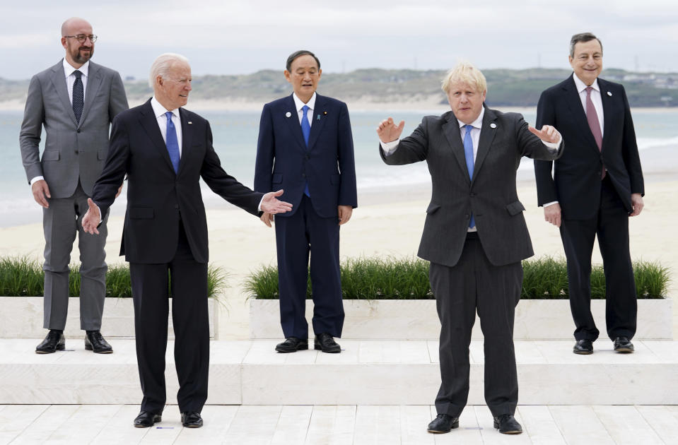 Leaders of the G7 pose during a group photo at the G7 meeting at the Carbis Bay Hotel in Carbis Bay, St. Ives, Cornwall, England, Friday, June 11, 2021. Leaders of the G7 begin their first of three days of meetings on Friday, in which they will discuss COVID-19, climate, foreign policy and the economy. Leaders from left, European Council President Charles Michel, U.S. President Joe Biden, Japan's Prime Minister Yoshihide Suga, British Prime Minister Boris Johnson and Italy's Prime Minister Mario Draghi. (Phil Noble, Pool via AP)