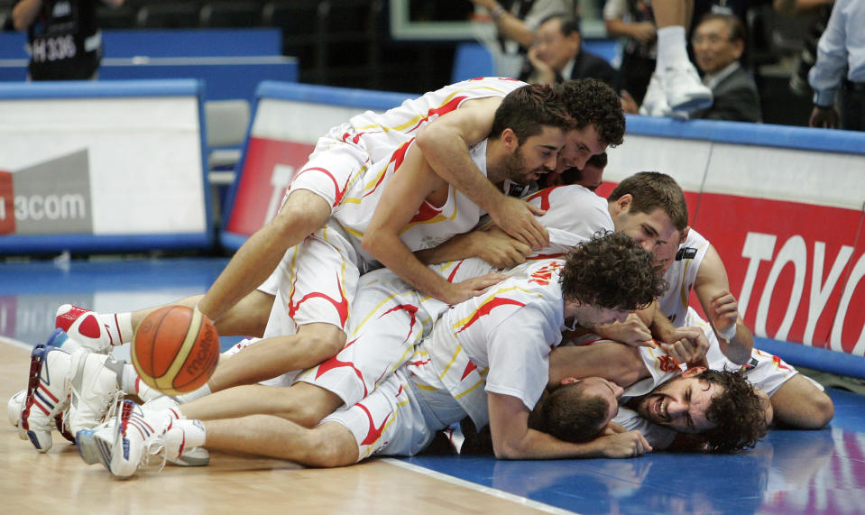 FILE - In this Sept. 1, 2006, file photo, Spain team members celebrate after defeating Argentina in the semifinals of the World Basketball Championships in Saitama, Japan. The 2006 world championship was perhaps the last truly wide-open international basketball event. Argentina arrived as the Olympic champion and Spain left as the world champion, the last time for a long while anyone other than the U.S. would hold either title. (AP Photo/Mark J. Terrill, File)