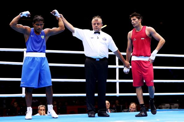 LONDON, ENGLAND - JULY 30:   Yamaguchi Falcao Florentino of Brazil celebrates his victory over Sumit Sangwan of India during their Men's Heavy (81kg) Boxing on Day 3 of the London 2012 Olympic Games at ExCeL on July 30, 2012 in London, England.  (Photo by Scott Heavey/Getty Images)