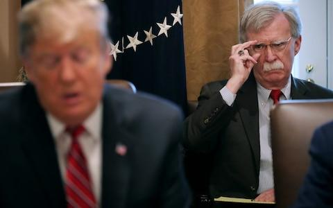 <span>There had been hopes that Donald Trump's firing on national security adviser John Bolton (right) would ease tensions over Iran</span> <span>Credit: Chip Somodevilla/Getty Images North America </span>