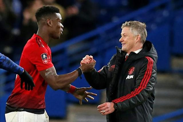 Manchester United manager Ole Gunnar Solskjaer (right) says Paul Pogba is working hard to get back to full fitness (AFP Photo/Ian KINGTON)