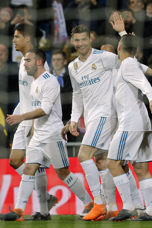 Real Madrid's Cristiano Ronaldo, center, celebrates after scoring during a Spanish La Liga soccer match between Real Madrid and Girona at the Santiago Bernabeu stadium in Madrid, Spain, Sunday, March 18, 2018. (AP Photo/Paul White)