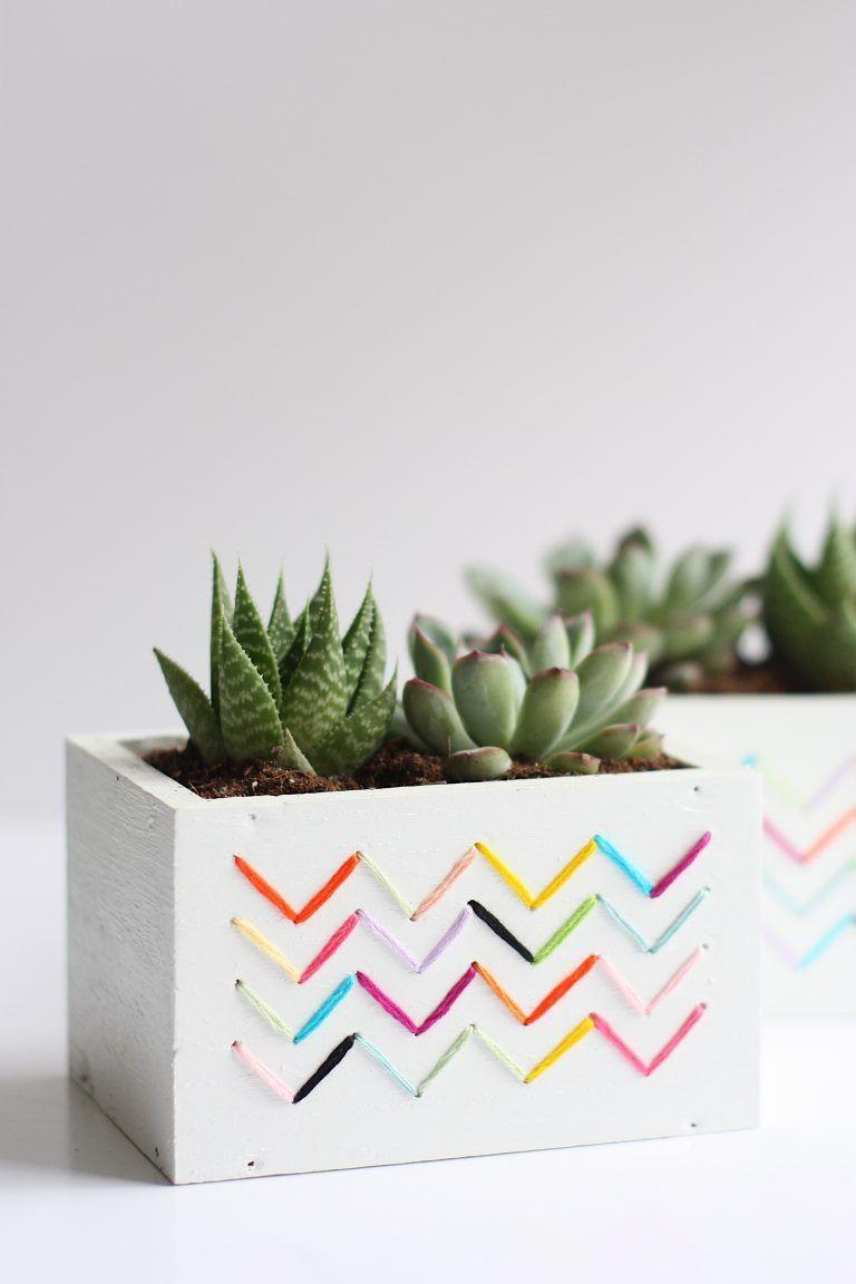 """<p>Why, yes—you <em>can</em> embroider a planter! All you have to do is drill holes into a wood box planter and work your magic with embroidery floss.</p><p><strong>Get the tutorial at <a href=""""https://prettylifegirls.com/2017/04/diy-stitched-planters.html"""" rel=""""nofollow noopener"""" target=""""_blank"""" data-ylk=""""slk:The Pretty Life Girls"""" class=""""link rapid-noclick-resp"""">The Pretty Life Girls</a>.</strong></p><p><a class=""""link rapid-noclick-resp"""" href=""""https://go.redirectingat.com?id=74968X1596630&url=https%3A%2F%2Fwww.walmart.com%2Fip%2FCoats-Clark-Value-Pack-Basic-Multicolor-Embroidery-Floss-8-75-yards-36-pack%2F20743483&sref=https%3A%2F%2Fwww.thepioneerwoman.com%2Fhome-lifestyle%2Fgardening%2Fg36556911%2Fdiy-planters%2F"""" rel=""""nofollow noopener"""" target=""""_blank"""" data-ylk=""""slk:SHOP EMBROIDERY FLOSS"""">SHOP EMBROIDERY FLOSS</a></p>"""