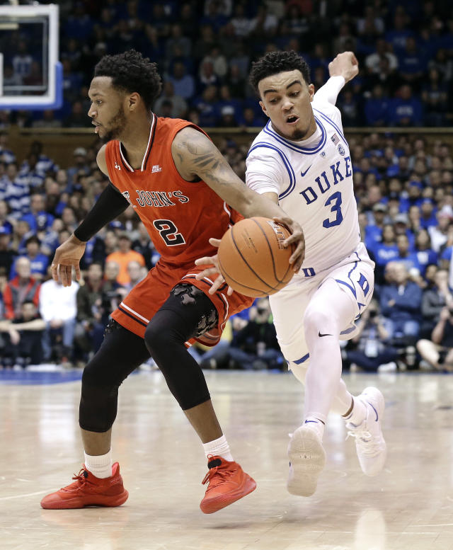 Duke's Tre Jones (3) reaches for the ball while St. John's Shamorie Ponds (2) dribbles during the first half of an NCAA college basketball game in Durham, N.C., Saturday, Feb. 2, 2019. (AP Photo/Gerry Broome)