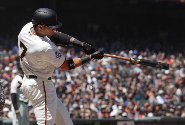 San Francisco Giants' Gorkys Hernandez hits a two-run single against the Miami Marlins during the sixth inning of a baseball game in San Francisco, Wednesday, June 20, 2018. (AP Photo/Jeff Chiu)