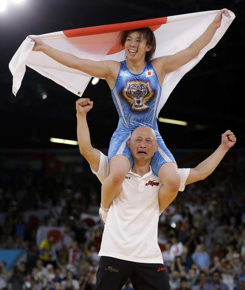 Saori Yoshida of Japan celebrates after she beat Tonya Lynn Verbeek of Canada for the gold medal during their 55-kg women's freestyle wrestling competition at the 2012 Summer Olympics, Thursday, Aug. 9, 2012, in London. (AP Photo/Paul Sancya)
