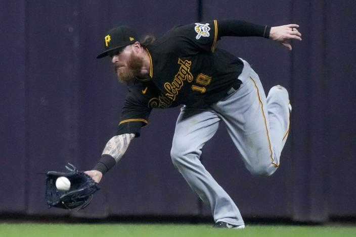 Pittsburgh Pirates' Ben Gamel makes a running catch on a ball hit by Milwaukee Brewers' Brandon Woodruff during the fourth inning of a baseball game Friday, June 11, 2021, in Milwaukee. (AP Photo/Morry Gash)