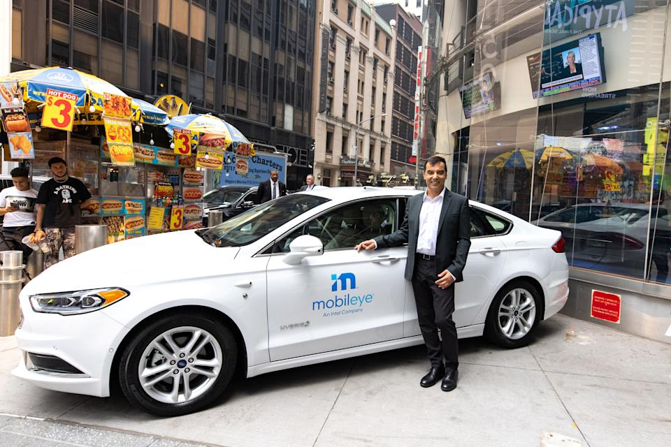 Mobileye's CEO Amnon Shashua poses with a Mobileye driverless vehicle at the Nasdaq Market site in New York, U.S., July 20, 2021. REUTERS/Jeenah Moon